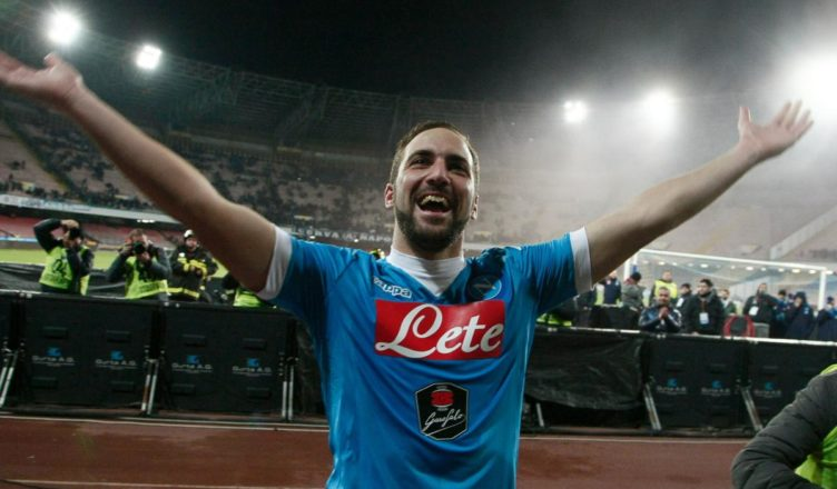 Napoli's Argentinian French forward Gonzalo Higuain celebrates with fans after winning the Italian Serie A football match Napoli and Sassuolo Calcio at the San Paolo stadium in Naples